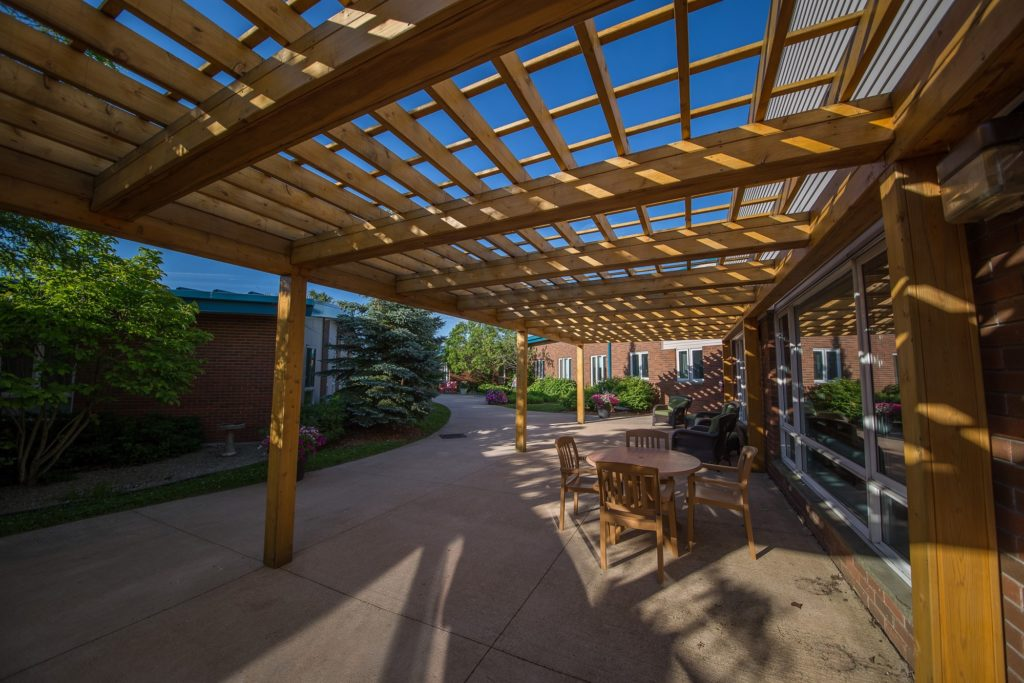 Sitting area under the pergola outside Oak Court